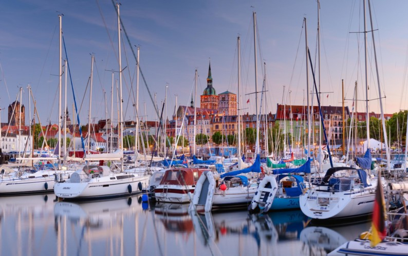 Stralsund, Mecklenburg-Vorpommern, Germany - View across CityMarina Stralsund and hafen with St.Nikolai-Kirche in the background and yachts in the foreground.