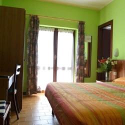 Ein Zimmer in der italienischen Ferienanlage La Capannina.