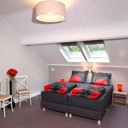 Ein Doppelzimmer im niederländischen Freizeitheim De Sterre für Kinder und Jugendreisen.